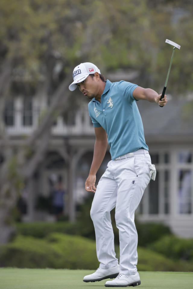Satoshi Kodaira, of Japan, celebrates a birdie putt on the 17th green during a three-hole playoff against Si Woo Kim, of South Korea, during the final round of the RBC Heritage golf tournament in Hilton Head Island, S.C., Sunday, April 15, 2018. (AP Photo/Stephen B. Morton)