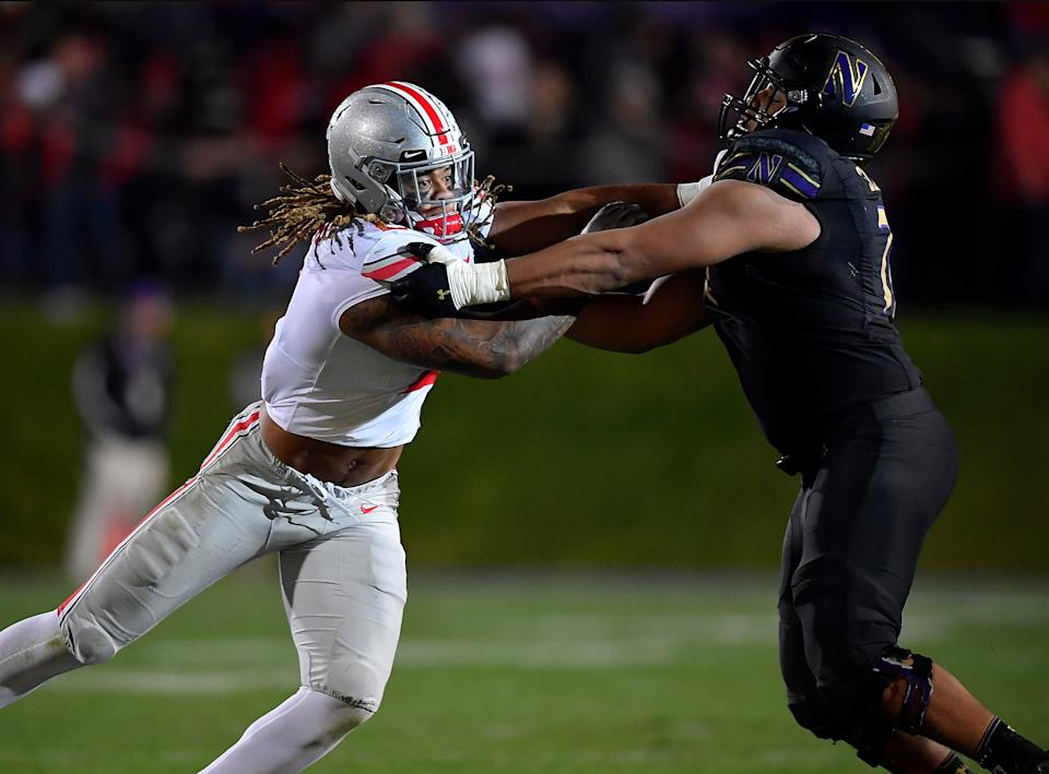Northwestern OT Rashawn Slater, right, held up extremely well in his 2019 head-to-head battle with Ohio State's Chase Young, the No. 2 overall pick in the 2020 NFL draft. (Photo by Quinn Harris/Getty Images)