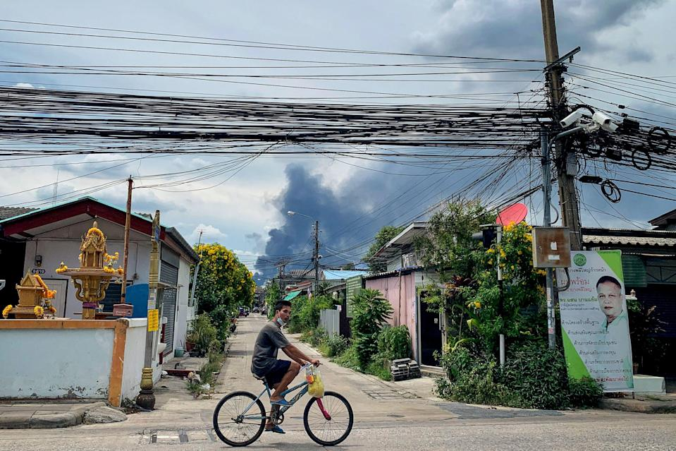 Smoke billows from the explosion and fire (AFP via Getty Images)