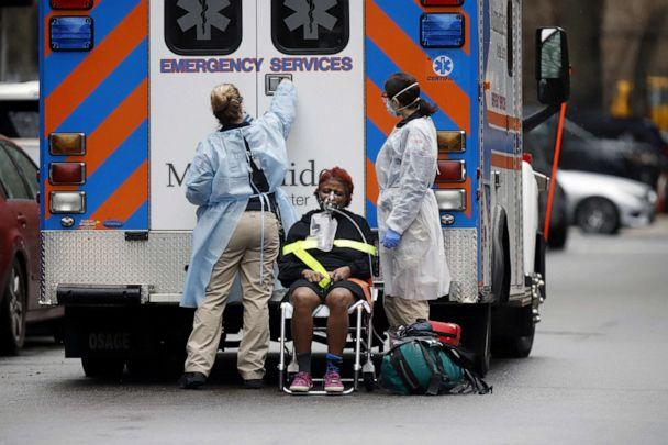 PHOTO: Emergency Medical Technicians (EMT) wearing protective gears wheel a sick patient to a waiting ambulance during the outbreak of coronavirus disease (COVID-19) in, New York, March 28, 2020.  (Stefan Jeremiah/Reuters, FILE)