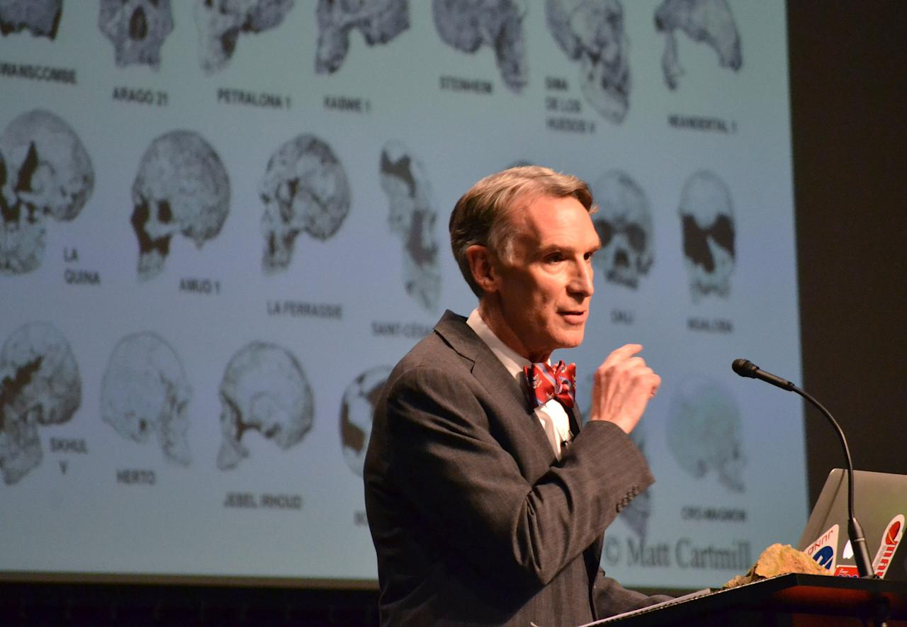 """TV's """"Science Guy"""" Bill Nye stand speaks during a debate on evolution with Creation Museum head Ken Ham, Tuesday, Feb. 4, 2014, at the Petersburg, Ky. museum. Ham believes the Earth was created 6,000 years ago by God and is told strictly through the Bible. Nye says he is worried the U.S. will not move forward if creationism is taught to children. (AP Photo/Dylan Lovan)"""