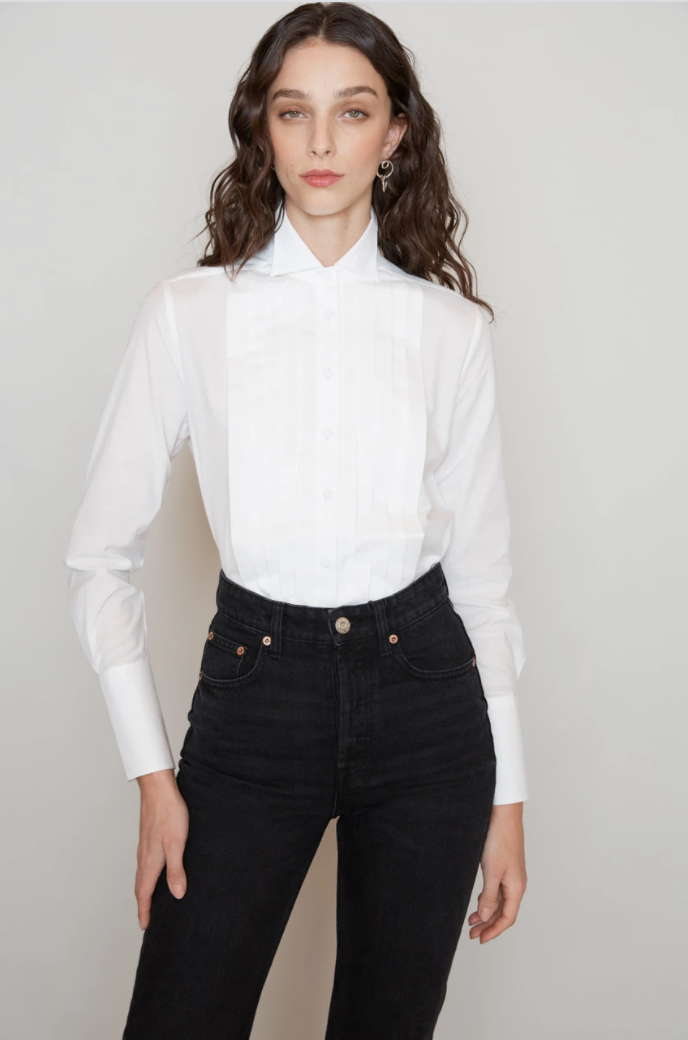 """<p>meme-chose.com</p><p><strong>$185.00</strong></p><p><a href=""""https://www.meme-chose.com/collections/shop_womens_dress_shirts/products/meme_chose_fisher_womens_silk_tuxedo_shirt"""" rel=""""nofollow noopener"""" target=""""_blank"""" data-ylk=""""slk:Shop Now"""" class=""""link rapid-noclick-resp"""">Shop Now</a></p><p>A tuxedo-style shirt offers a sexy menswear edge to the classic button down.</p><p><strong>More: </strong><a href=""""https://www.townandcountrymag.com/style/fashion-trends/a28676205/how-to-wear-white-button-down-shirt"""" rel=""""nofollow noopener"""" target=""""_blank"""" data-ylk=""""slk:How to Wear a Classic White Button Down Shirt for Any Occasion"""" class=""""link rapid-noclick-resp"""">How to Wear a Classic White Button Down Shirt for Any Occasion</a></p>"""