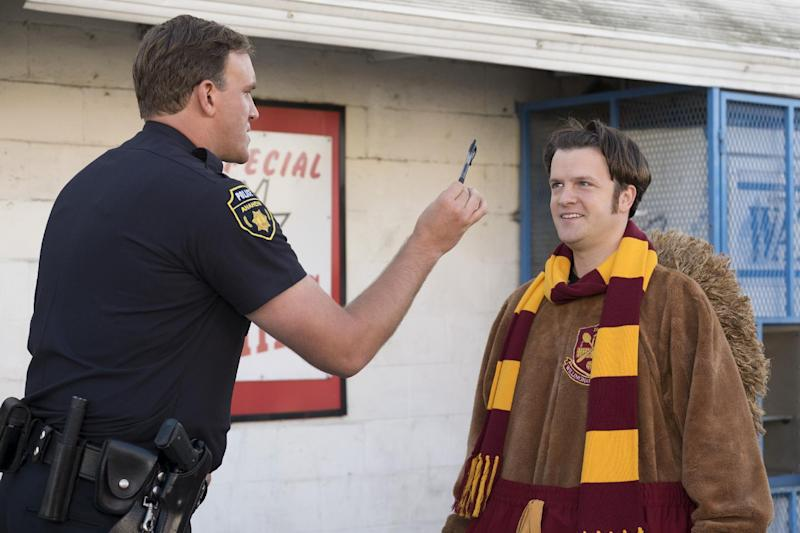 """This image released by Netflix shows Tom Bennett in a scene from """"Mascots."""" (Scott Garfield/Netflix via AP)"""