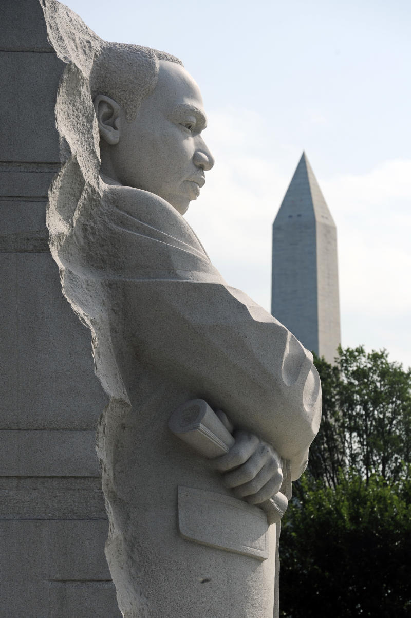 The Martin Luther King, Jr. Memorial is seen with the Washington Monument behind it in Washington, Friday, Aug. 26, 2011. The memorial's dedication ceremony has been postponed due to the impending arrival of Hurrican Irene.  (AP Photo/Cliff Owen)