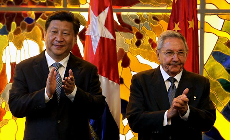 Chinese President Xi Jinping meets his Cuban counterpart Raul Castro at the Revolution Palace in Havana, on July 22, 2014, in this photo from the Cuban official website www.cubadebate.cu