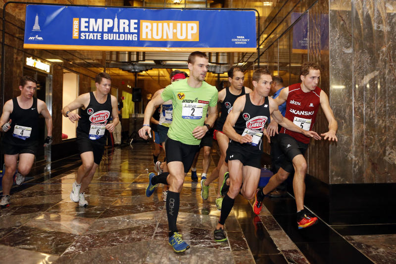 Slovakia's Tomas Celko (2), Australia's Darren Wilson, second from right, and Norway's Thorbjorn Ludvigsen (5) lead the men's division as they sprint for the stairs at the start of the Empire State Building Run-Up on Wednesday, Feb. 5, 2014, in New York. Ludvigsen won the race. (AP Photo/Jason DeCrow)