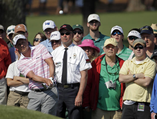 Luke Donald, of England, chips to the second green during the second round of the Masters golf tournament Friday, April 11, 2014, in Augusta, Ga. (AP Photo/Chris Carlson)
