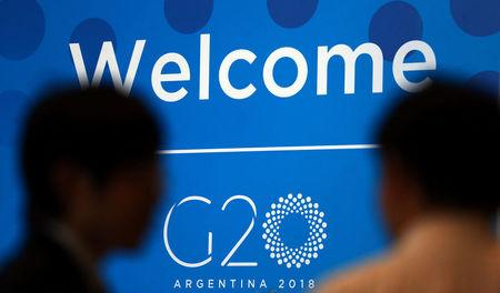 Two men talk at the G20 Meeting of Finance Ministers in Buenos Aires, Argentina, March 19, 2018. REUTERS/Marcos Brindicci