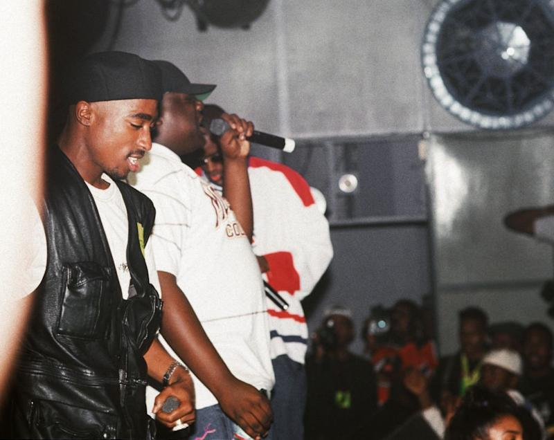 Rappers Tupac Shakur and The Notorious B.I.G. can be seen performing together on stage.