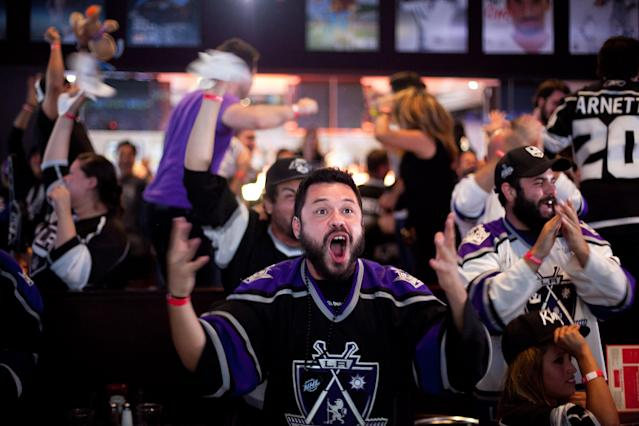 LOS ANGELES, CA - JUNE 11: Fans celebrate a goal scored by the Los Angeles Kings during Game 6 of the 2012 Stanley Cup Final June 11, 2012 in Los Angeles, California. A win in Game 6 against the New Jersey Devils would lead the Los Angeles Kings to their first championship in franchise history. (Photo by Jonathan Gibby/Getty Images)