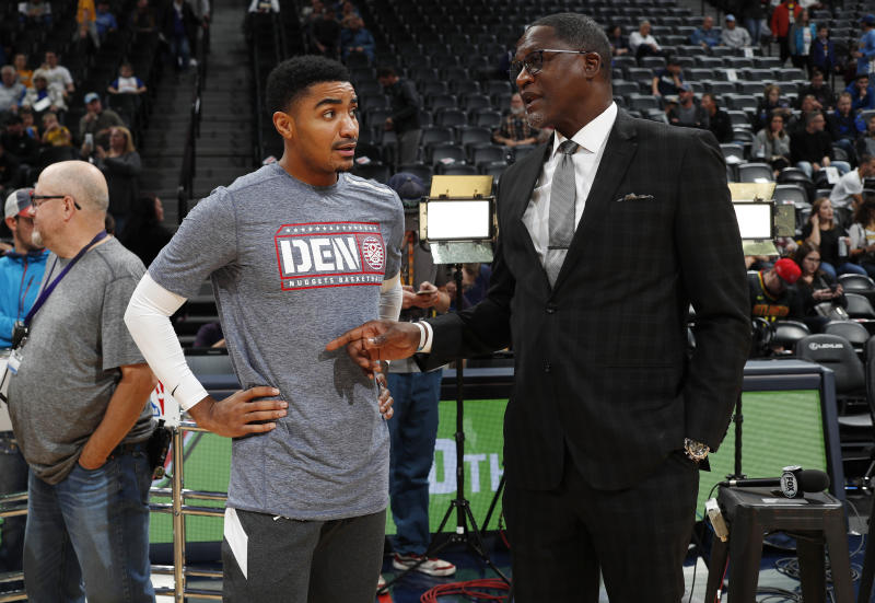 Denver Nuggets guard Gary Harris, left, chats with Atlanta Hawks announcer Dominique Wilkins before an NBA basketball game Tuesday, Nov. 12, 2019, in Denver. (AP Photo/David Zalubowski)