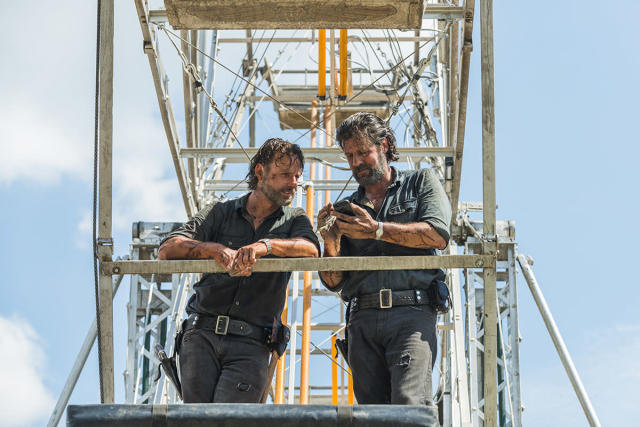 "<p>Andrew Lincoln and his stunt double Felipe Savahge peruse cell phone pics while hanging around a ferris wheel in ""Say Yes.""<br><br>(Photo: AMC) </p>"
