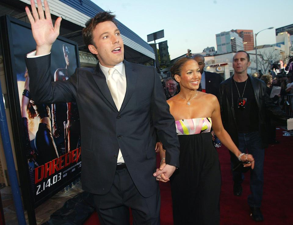 """Ben Affleck waving and Jennifer Lopez holding his hand at the premiere of """"Daredevil."""""""