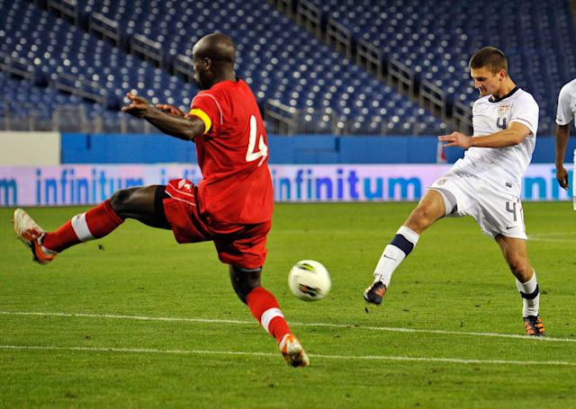 NASHVILLE, TN - MARCH 24: Perry Kitchen #4 of the USA takes a shot towards Nana Attakora-Gyan #4 of Canada in a 2012 CONCACAF Men's Olympic Qualifying match at LP Field on March 24, 2012 in Nashville, Tennessee. (Photo by Frederick Breedon/Getty Images)