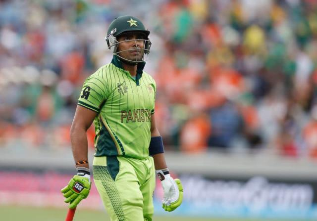 FILE PHOTO: Pakistan's Umar Akmal looks up at his dismissal on the big screen during their Cricket World Cup match against South Africa in Auckland