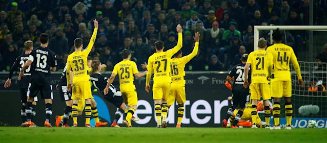 Soccer Football - Bundesliga - Borussia Moenchengladbach vs Borussia Dortmund - Borussia-Park, Moenchengladbach, Germany - February 18, 2018 Borussia Monchengladbach's Jannik Vestergaard scores a goal which is later disallowed by Referee Bastian Dankert (not pictured) after referring to VAR (Video Assistant Referee) REUTERS/Thilo Schmuelgen DFL RULES TO LIMIT THE ONLINE USAGE DURING MATCH TIME TO 15 PICTURES PER GAME. IMAGE SEQUENCES TO SIMULATE VIDEO IS NOT ALLOWED AT ANY TIME. FOR FURTHER QUERIES PLEASE CONTACT DFL DIRECTLY AT + 49 69 650050