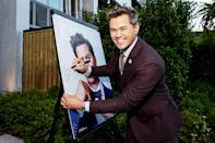 """<p>Andrew Rannells signs his portrait at Los Angeles Confidential celebrates """"Portraits of Pride"""" on June 9 in L.A.</p>"""