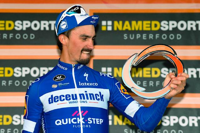 French rider Julian Alaphilippe celebrates on podium after winning the sprint at the end of the 291-kilometer (181-mile) route along the Italian Riviera for the 110th edition of the Milano-Sanremo cycling classic, in Sanremo, Italy, Saturday, March 23, 2019. (Dario Belinghieri/ANSA via AP)