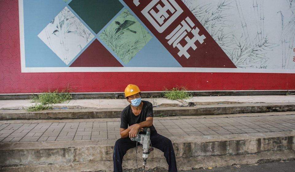 A migrant worker waits to be employed on the street in Beijing, China in August 2020. 17 August 2020. Photo: EPA-EFE