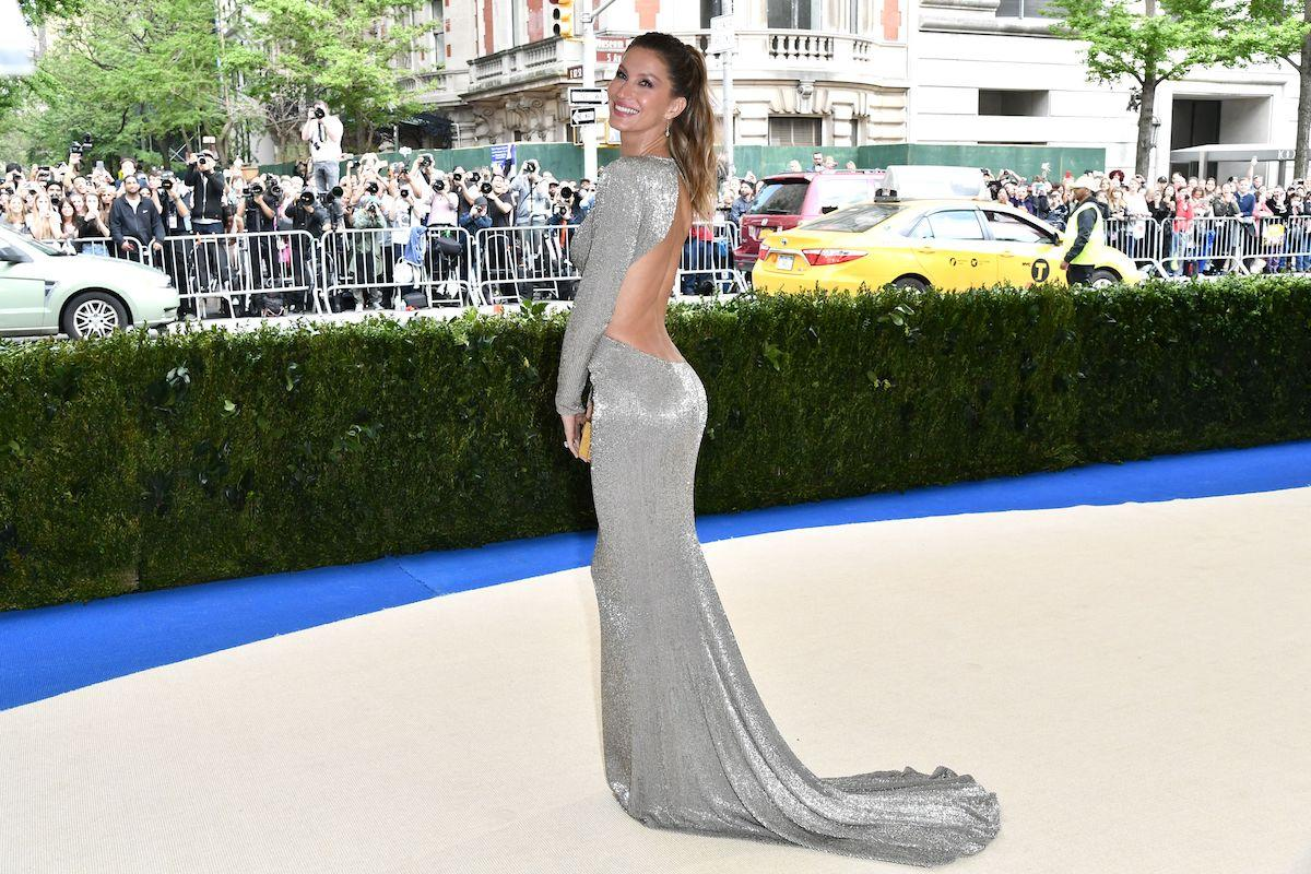 <div>The supermodel and co-chair of the 2017 Met Gala wore a sustainable, backless metallic gown by designer Stella McCartney. She styled her hair in a high ponytail. (Photo: Rob Latour/REX) </div>