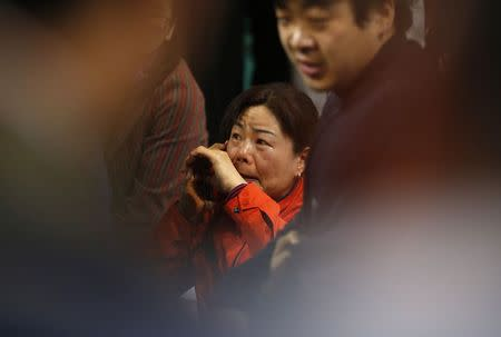 "A family member of a missing passenger on the South Korean ferry ""Sewol"" which sank at sea cries as she wait for news from a rescue team at a gym in Jindo April 17, 2014. REUTERS/Kim Hong-Ji"