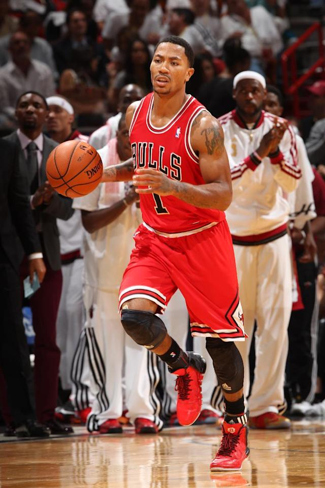 MIAMI, FL - OCTOBER 29: Derrick Rose #1 of the Chicago Bulls dribbles up the court against the Miami Heat on October 29, 2013 at AmericanAirlines Arena in Miami, Florida. (Photo by Joe Murphy/NBAE via Getty Images)