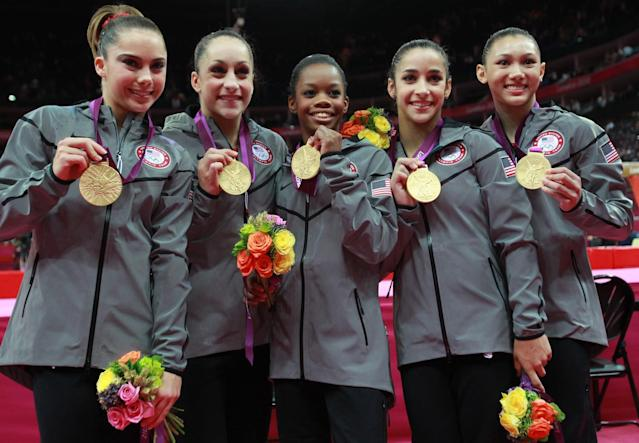 <p>McKayla Maroney, Jordyn Wieber, Gabrielle Douglas, Alexandra Raisman and Kyla Ross of the United States celebrate after winning the gold medal in the Artistic Gymnastics Women's Team final on Day 4 of the London 2012 Olympic Games at North Greenwich Arena on July 31, 2012 in London, England. (Photo by Ronald Martinez/Getty Images) </p>