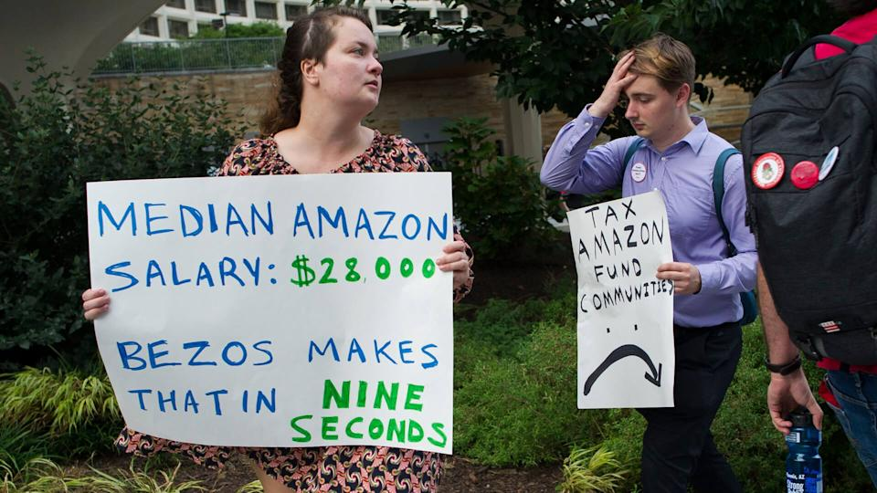 Mandatory Credit: Photo by Cliff Owen/AP/Shutterstock (9881640b)Demonstrators protest against Amazon and Jeff Bezos, Amazon founder and CEO, outside of the hotel where the Economic Club of Washington is having their Milestone Celebration in Washington, .