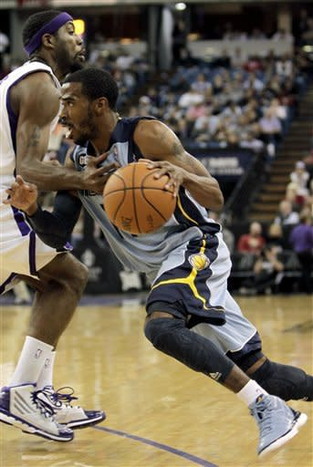Memphis Grizzlies guard Mike Conley, right, drives to the basket against Sacramento Kings forward John Salmons during the first quarter of an NBA basketball game in Sacramento, Calif., Tuesday, March 20, 2012. (AP Photo/Rich Pedroncelli)