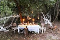 "<p>Why not head outside? If the weather's nice, an outdoor feast might be a fun idea—and we guarantee those ghost stories will be doubly spooky out in the woods.</p><p><strong>Get the tutorial at <a href=""https://thesummeryumbrella.com/halloween-table-decor/"" rel=""nofollow noopener"" target=""_blank"" data-ylk=""slk:The Summery Umbrella"" class=""link rapid-noclick-resp"">The Summery Umbrella</a>.</strong></p><p><strong><a class=""link rapid-noclick-resp"" href=""https://www.amazon.com/Klikel-Spooky-Halloween-5-light-Candelabra/dp/B00K9ZJRBE?tag=syn-yahoo-20&ascsubtag=%5Bartid%7C10050.g.4620%5Bsrc%7Cyahoo-us"" rel=""nofollow noopener"" target=""_blank"" data-ylk=""slk:SHOP SPOOKY CANDELABRAS"">SHOP SPOOKY CANDELABRAS</a><br></strong></p>"