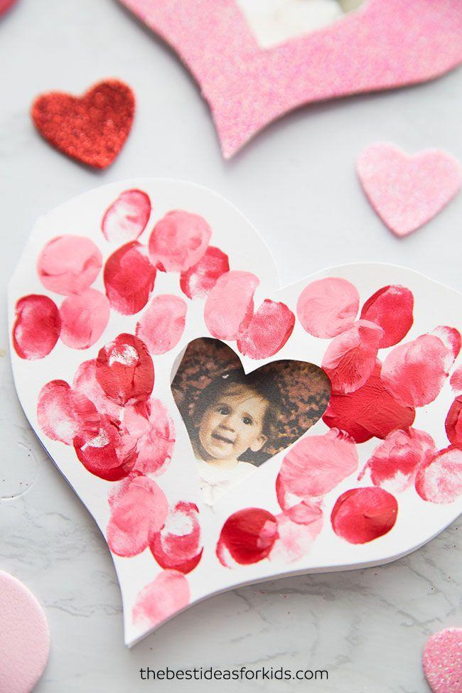 """<p>Few tots can pass up a good old finger painting session. Help them cut out the heart shape, then let their little paint-soaked fingerprints do the decorating. </p><p><strong>Get the tutorial at <a href=""""https://www.thebestideasforkids.com/fingerprint-heart-card/"""" rel=""""nofollow noopener"""" target=""""_blank"""" data-ylk=""""slk:The Best Ideas for Kids"""" class=""""link rapid-noclick-resp"""">The Best Ideas for Kids</a>. </strong></p><p><strong><a class=""""link rapid-noclick-resp"""" href=""""https://www.amazon.com/Crayola-Washable-FingerPaints-Stocking-Stuffers/dp/B00MC7WV6K/?tag=syn-yahoo-20&ascsubtag=%5Bartid%7C10050.g.4233%5Bsrc%7Cyahoo-us"""" rel=""""nofollow noopener"""" target=""""_blank"""" data-ylk=""""slk:SHOP PAINT"""">SHOP PAINT</a><br></strong></p>"""