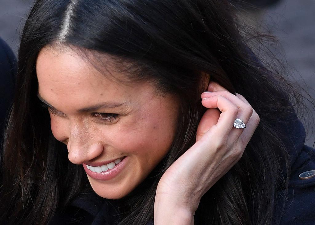 "<p>From a chic white tie-waist coat to the telling ""Husband"" shirt and expensive blue ripped jeans — and who could forget the <a rel=""nofollow"" href=""https://ca.style.yahoo.com/meghan-markles-engagement-ring-pays-slideshow-wp-171650090.html"">gorgeous ring</a>? Meghan Markle's style is either being <a rel=""nofollow"" href=""https://www.yahoo.com/lifestyle/meghan-markle-broke-major-royal-rule-engagement-announcement-160407595.html"">criticized</a>, copied or selling like hot cakes. Click through the gallery and check out the top style moments of the year from the woman who won Prince Harry's heart! <em>(Photo: Getty)</em> </p>"