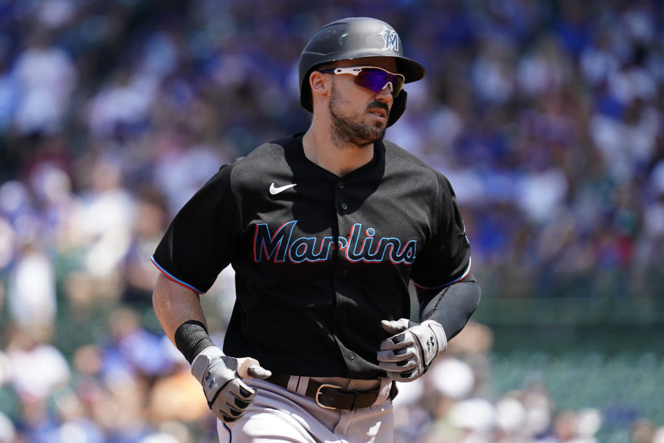Miami Marlins' Adam Duvall rounds the bases after hitting a two-run home run during the third inning of a baseball game against the Chicago Cubs in Chicago, Saturday, June 19, 2021. (AP Photo/Nam Y. Huh)