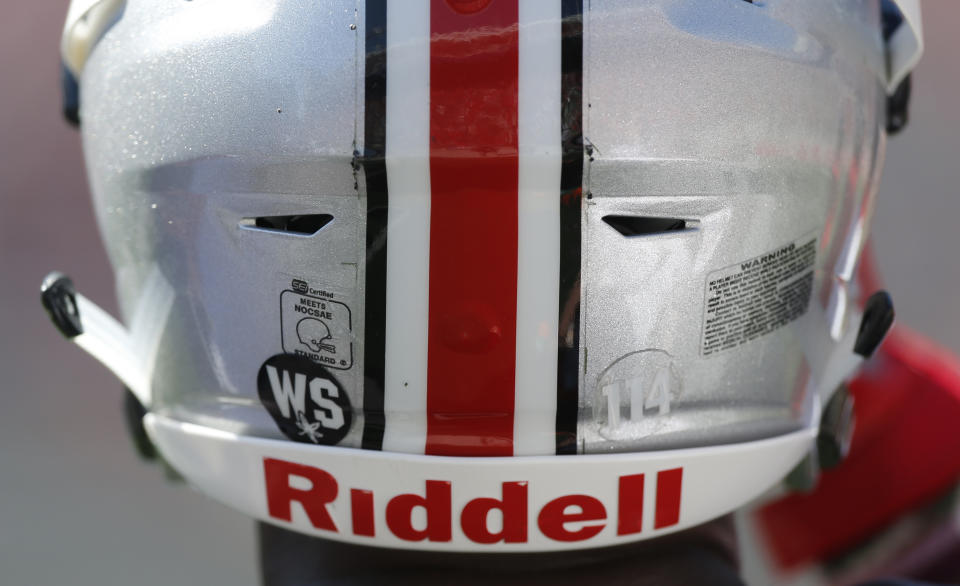 """A """"WS"""" sticker is displayed on an Ohio State helmet honoring former player Will Smith during Ohio State's NCAA college football spring game Saturday, April 16, 2016, in Columbus, Ohio. Smith was murdered last week in New Orleans. (AP Photo/Jay LaPrete)"""