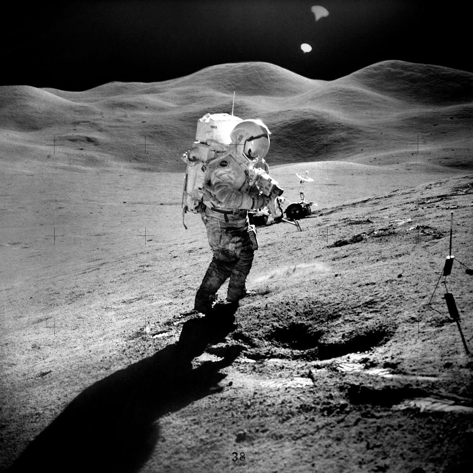 Scientific collection on the moon during the Apollo 15 mission.