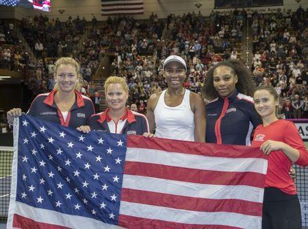 Feb 11, 2018; Asheville, NC, USA;Coco Vandeweghe (USA), Team Captain, Kathy Rinaldi, Venus Williams (USA), Serena Williams (USA) and Lauren Davis (USA) celebrate the USA the Fed Cup tie against the Netherlands at U.S. Cellular Center. Susan Mullane-USA TODAY Sports