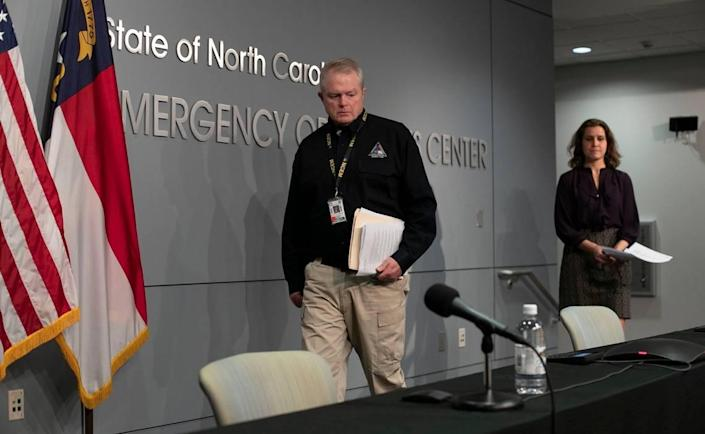 Mike Sprayberry, North Carolina Director of Emergency Management, and Dr. Elizabeth Cuervo Tilson, North Carolina State Health Director, Chief Medical Officer, arrive for a press briefing to update the public on the COVID-19 virus on Tuesday, March 24, 2020 at the Emergency Operations Center in Raleigh, N.C.