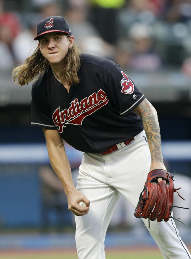 Cleveland Indians starting pitcher Mike Clevinger reacts after Cincinnati Reds' Joey Votto hit a solo home run in the fifth inning of a baseball game, Monday, July 9, 2018, in Cleveland. (AP Photo/Tony Dejak)