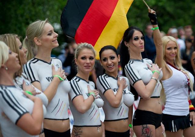 Porn actresses with body paint football jerseys in the colors of Germany poses as they take part in a fun soccer match of Germany vs Denmark on June 16, 2012 in Berlin, one day before the Euro 2012 football championship's match Germany vs Denmark to take place in Lviv, Ukraine. In the fun match, the girls of Denmark won 13-1. AFP PHOTO / JOHANNES EISELEJOHANNES EISELE/AFP/GettyImages