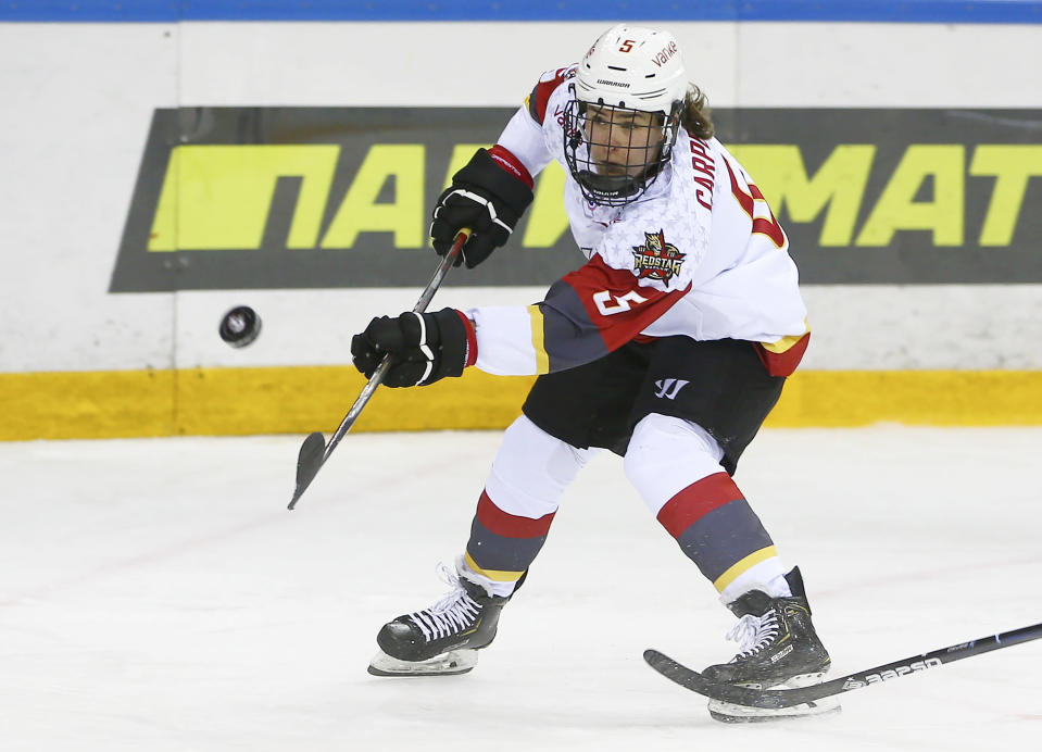 This photo provided by KHL-Marketing shows Alexandra Carpenter as she plays hockey for the KRS Vanke Rays on Oct. 15, 2019 in Ufa, Russia. Carpenter, college hockey's top player in 2015 and daughter of former NHL star Bobby Carpenter, is leading Russia's Women's Hockey League in scoring while playing for the Chinese-based Shenzhen KRS Vanke Rays. (Sadykova Svetlana/KHL-Marketing via AP)