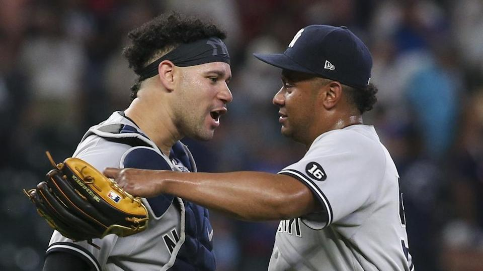 Wandy Peralta and Gary Sanchez celebrate win over Braves