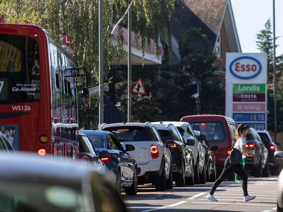 A queue forms for an Esso petrol station in London (Getty Images)