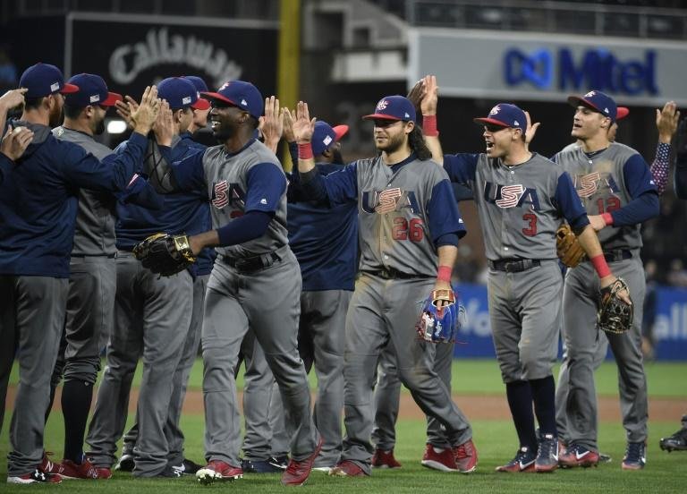 United States players celebrate after beating the Dominican Republic 6-3 in World Baseball Classic to reach the semi-finals