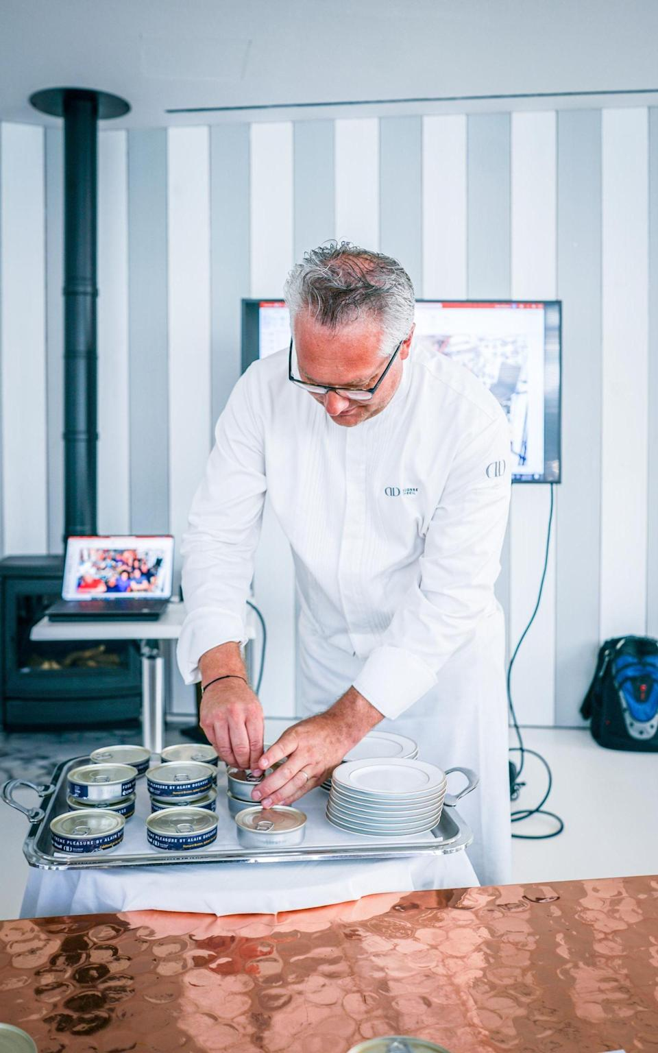 A chef demonstrates how tinned meals are made for the International Space Station