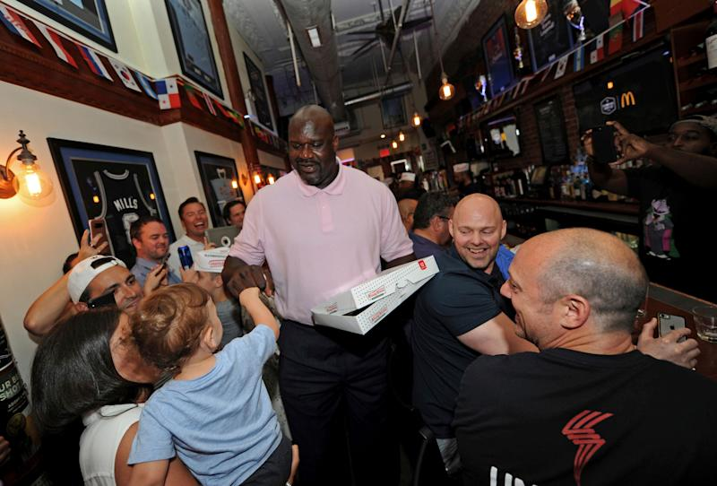 IMAGE DISTRIBUTED FOR KRISPY KREME DOUGHNUTS - Basketball Hall of Famer and Krispy Kreme Doughnuts global ambassador Shaquille O'Neal celebrates World Chocolate Day by surprising soccer fans with Krispy Kreme Chocolate Glaze Doughnuts, Friday, July 6, 2018 at The Australian pub in New York. Krispy Kreme is offering the rare doughnuts for one day only Saturday, July 7, 2018 – World Chocolate Day – at participating locations throughout the U.S. and on six continents. (Diane Bondareff/AP Images for Krispy Kreme Doughnuts)