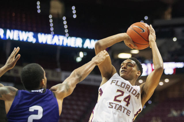 Florida State guard Devin Vassell (24) shoots over North Alabama guard Christian Agnew during a December game. (AP Photo/Mark Wallheiser)
