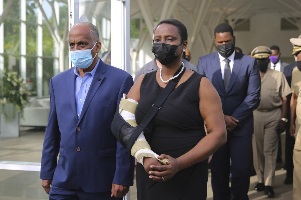 First Lady Martine Moise arrives for a tribute for her late husband President Jovenel Moise at the National Pantheon Museum in Port-au-Prince Haiti, Wednesday, July 21, 2021. President Moise was assassinated on July 7 during an attack at their home that left her injured. ( AP Photo/Joseph Odelyn)