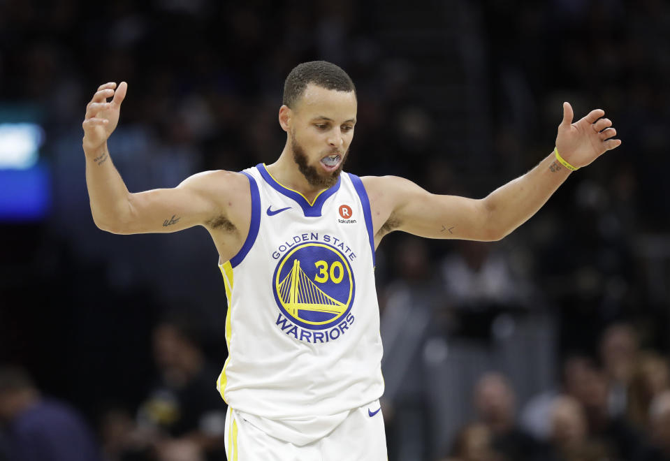 Stephen Curry and the Warriors overwhelmed the Cavaliers in Friday's Game 4 to secure their third NBA title in four years. (AP)