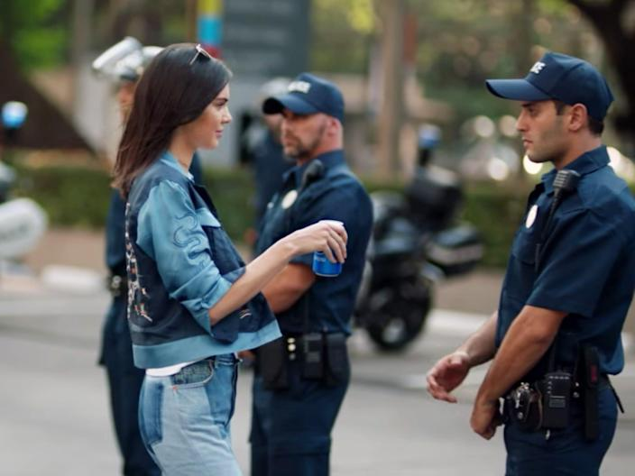 Kendall Jenner with police in a Pepsi ad.