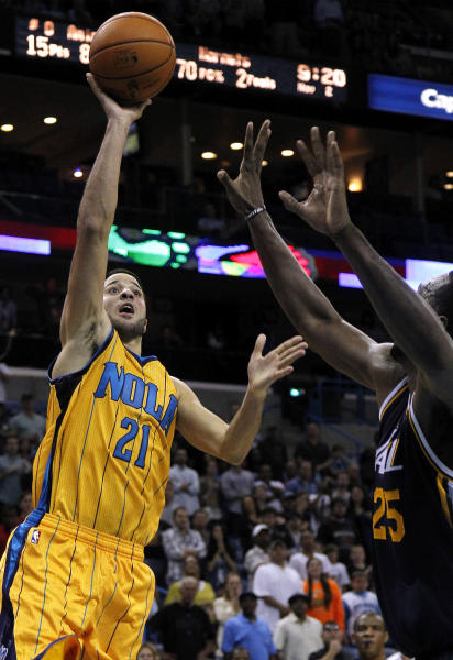 New Orleans Hornets point guard Greivis Vasquez (21) scores the winning basket in the fourth quarter over Utah Jazz center Al Jefferson (25) during an NBA basketball game in New Orleans, Friday, Nov. 2, 2012. The Hornet won 88-86. (AP Photo/Jonathan Bachman)
